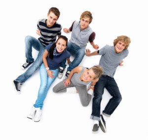 Top view of happy young people sitting on white floor